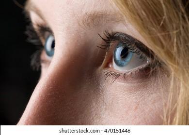 Closeup of a woman's blue eyes