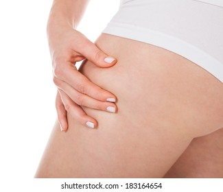 Close-up Of Woman's Buttocks Pinching Excessive Fat
