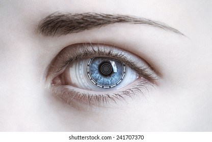 Close-up of woman's eye. New technologies and futuristic concept