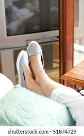 Close-up of woman's foot in a living-room