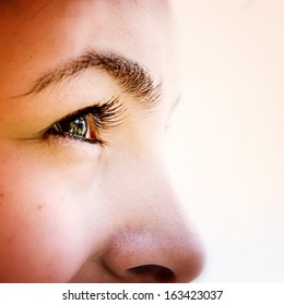 Close-up of  woman's green eyes.
