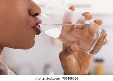 Close-up Of A Woman's Hand Drinking Glass Of Water