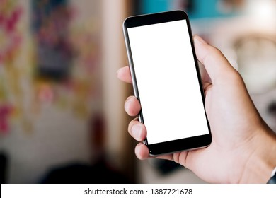 Close-up Of A Woman's Hand Holding Cell Phone With White Blank Screen