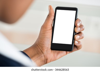 Close-up Of Woman's Hand Holding Mobile Phone With Blank Screen