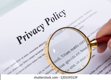 Close-up Of A Woman's Hand Holding Pen Over Privacy Policy Form