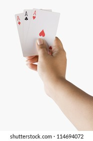 Close-up of a woman's hand holding playing cards