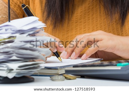 Closeup woman's hand writing messages on business desk