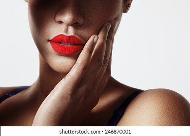 closeup of a woman's lips with a red matte lipstick