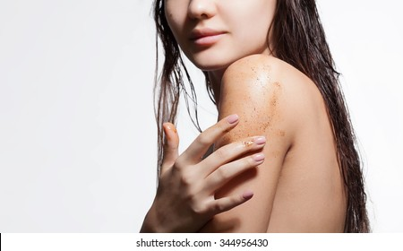 Close-up of a woman's shoulder with scrub of coffee