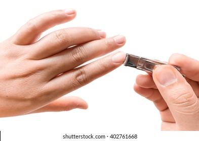 Closeup women cut fingernails on white background