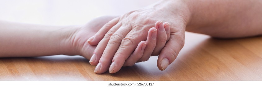 Close-up of women holding each other's hands