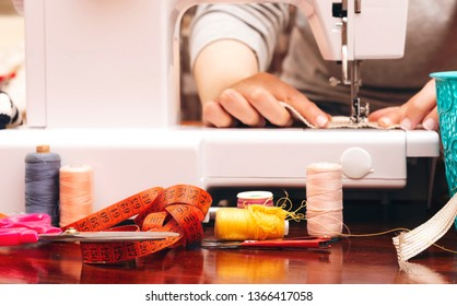 closeup women sewing on a machine