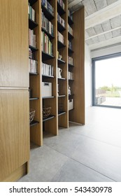 Close-up of wooden bookcase in stylish interior