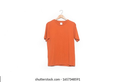 Closeup of Wooden Clothes hanger with brown cotton t-shirt,on white background.