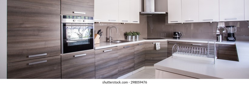 Close-up of wooden cupboards in cozy kitchen