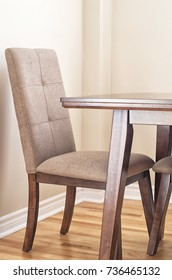 Closeup of wooden dining table and chair