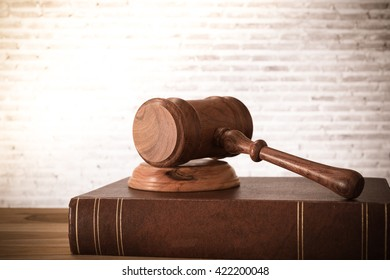 Closeup wooden judges gavel on table with law books. retro style. Concept of Legal.