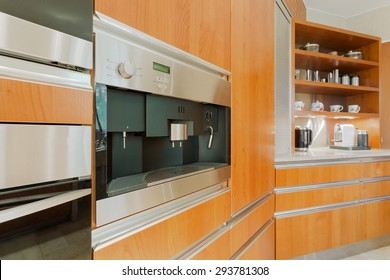 Close-up of wooden kitchen unit with coffeemaker
