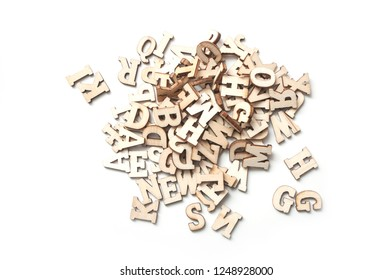 closeup of wooden letters stack on white background