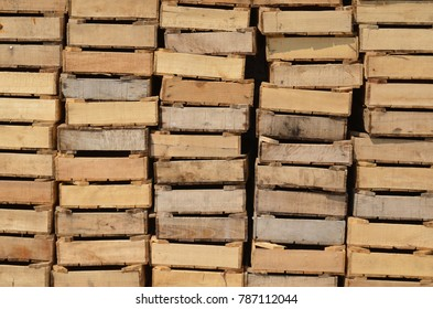 Closeup of wooden produce boxes stacked in a harbour