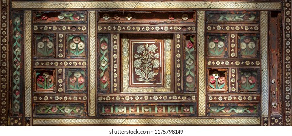 Closeup of wooden seamless floral pattern ornaments on old wooden chair, Cairo, Egypt