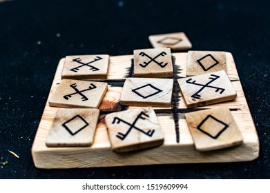 Closeup of wooden tic-tac-toe or oughts and crosses game made in pagan design. Criss cross board game.