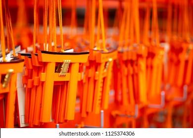 Closeup of Wooden Torii or Japanese gates amulets at Fushimi Inari shrine in Kyoto, Japan