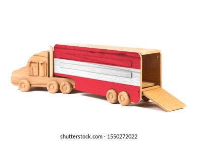 Close-up of a wooden toy truck with a painted national flag Austria. The concept of export-import,transportation, national delivery of goods