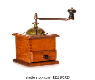 Close-up of wooden vintage coffee grinder with metal handle isolated on white background
