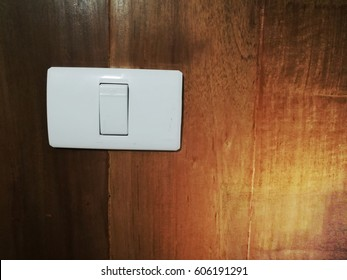 Closeup of wooden wall with light switch