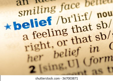 Close-up of word in English dictionary. Belief, definition and transcription