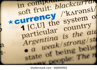 Close-up of word in English dictionary. Currency, definition and transcription