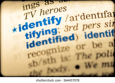 Close-up of word in English dictionary. Identity, definition and transcription