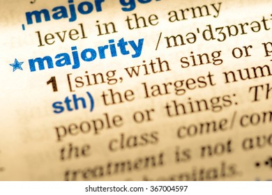 Close-up of word in English dictionary. Majority, definition and transcription