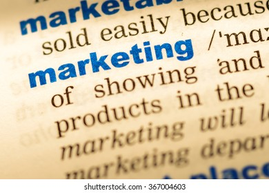 Close-up of word in English dictionary. Marketing, definition and transcription