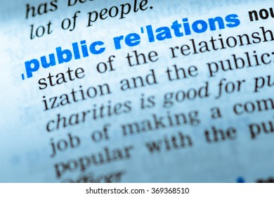 Close-up of word in English dictionary. Public relations, definition and transcription