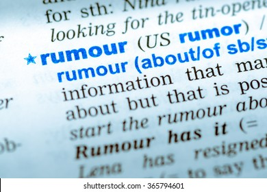 Close-up of word in English dictionary. Rumour, definition and transcription