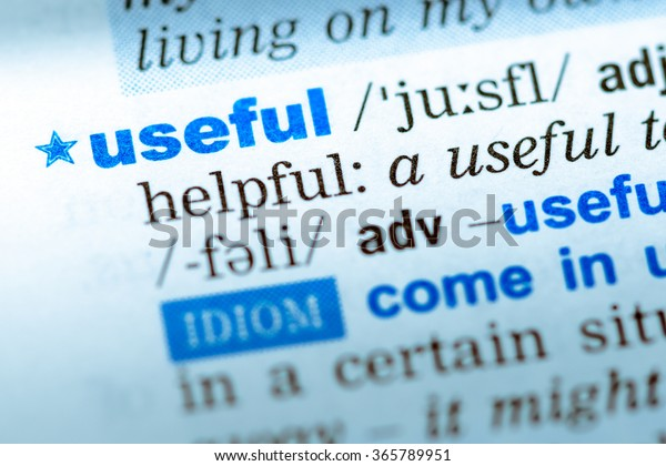 Close-up of word in English dictionary. Useful, definition and transcription