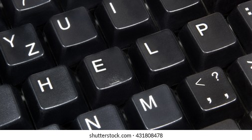 Close-up of word help on black computer keyboard.
