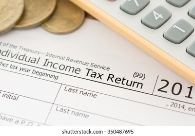 closeup words tax return in tax form. concept of tax form business financial. taxes concept.