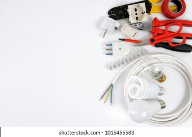 Close-up of work tools and electrical equipment on a white background with space for text / announcement.