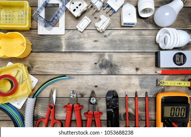 Close-up of work tools and electrical equipment on an antique wooden table with space for text / announcement