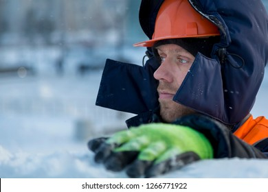 Close-up of a worker at the construction of an ice town for Christmas