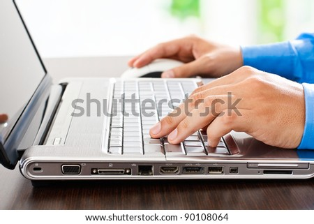Close-up of a worker using a laptop computer