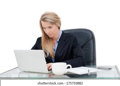 Close-up of working businesswoman. Woman's hands touching computer mouse and keys of silver opened laptop, against white background.