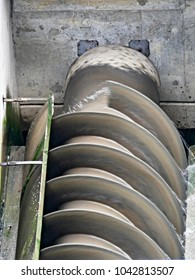 Close-up of working pumping station with screw of archimedes. Working screw of archimedes.