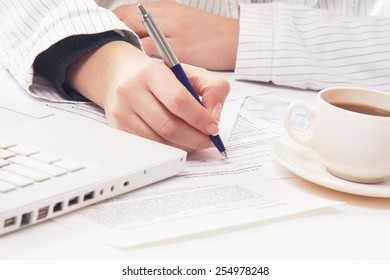 Close-up of a workplace of a businesswoman