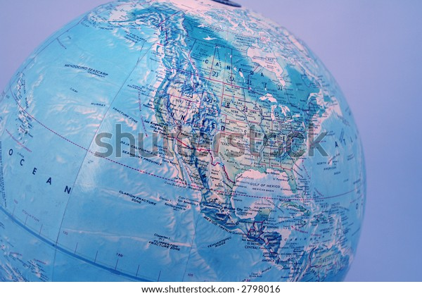 closeup of World globe with blue background
