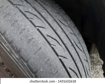 closeup of a worn out tyre with not equal tyre tread because of poor maintainance