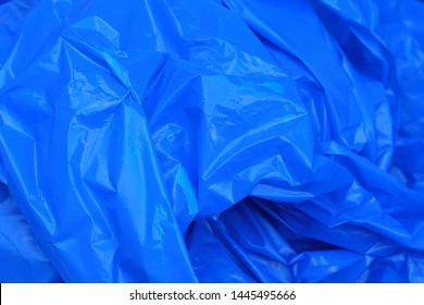 Closeup of a Wrinkled-Up Bright Blue Trash Bog